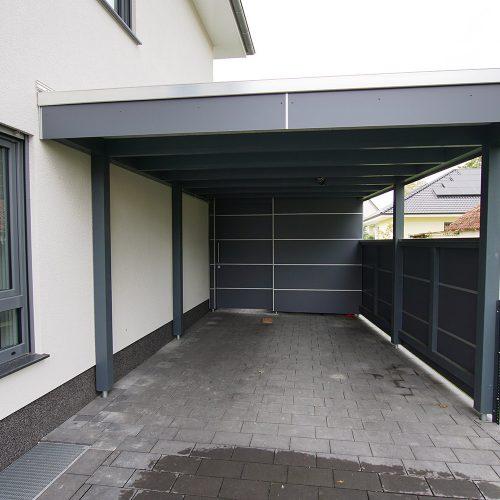 Flachdachcarport mit Abstellraum und HPL Platten in Verl